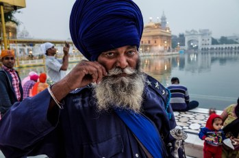 "Sat Sri Akaal- in the Punjabi language is a form of greeting used particularly by the followers of the Sikh religion. Roughly translated it means ""God is the ultimate truth"". The Golden Temple, Amritsar, Punjab India November 2015"